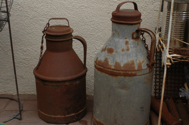 a pair of old 1900's milk cans